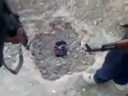 Assad troops burying captive alive, and filming